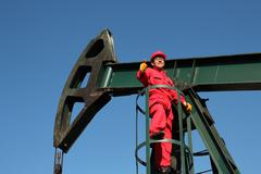 Successful Oil Worker at Work  Showing Thumbs Up Stock Photos