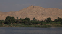 Camera boat, Nile river, trees and desert, Egypt Stock Footage