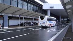Airport bus and waiting people in Narita Airport of Tokyo Stock Footage