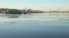 Sawdust Barge and Tugboat on Icy Fraser River Stock Footage