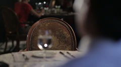 Man waiting for a woman in restaurant - stock footage