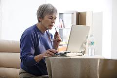 elderly person, computer - stock photo