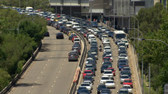 Cars stuck in heavy Sydney traffic during a hot summer's day PT6 Stock Footage