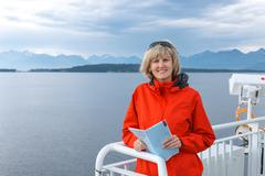 Woman tourist sailing on a sightseeing ferry boat Stock Photos