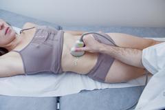 abdomen, ultrasound examination - stock photo