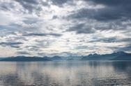 Stock Photo of Fjord scene with dramatic cloudy sky