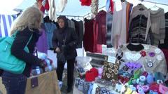 Women selling market handmade needlework crocheted jewelry Stock Footage