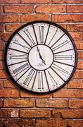 old vintage clock on textured brick wall - stock photo