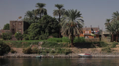 Camera boat - Nile shores and mosque, Egypt - stock footage