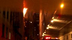4K 60fps - Debris falling off building fire Stock Footage