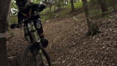SLOW MOTION: Biker riding downhill Stock Footage
