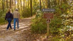 Couple Walking on Linville Falls, NC Hiking Path in Fall Stock Footage