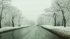 Asphalt road through the snowy winter morning park Stock Footage