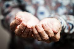 senior person hands begging for food or help - stock photo