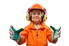 Little smiling child boy engineer or manual worker Stock Photos