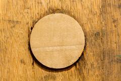 macro shot of bung in wooden bourbon barrel - stock photo