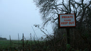Stock Video Footage of KEEP OUT sign - misty countryside dolly