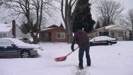 Stock Video Footage of Person Shoveling Snowy Driveway