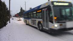 City Bus Driving on Snowy Street Stock Footage