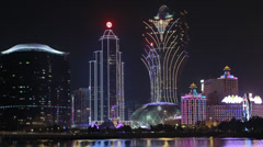 HD video of the Macau skyline and the Lisboa casino at night Stock Footage