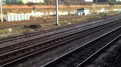 Gazing out of the window of a fast train at the tracks - stock footage
