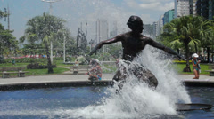 Statue of a surfer. Beach front garden, Santos, Sao Paulo, Brazil Stock Footage