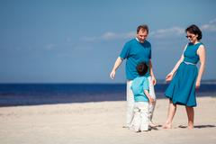 Young family of three having fun tropical beach Stock Photos