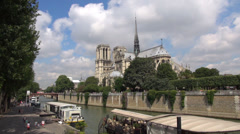 Timelapse Notre Dame cloud pass blue sky summer holiday promenade sidewalk Paris Stock Footage
