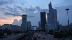 Timelapse La Defense district traffic car street metro train pass Paris twilight Stock Footage