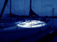 A yacht in a marina at night Stock Photos