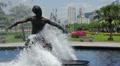 Statue of a surfer. Beach front garden, Santos, Sao Paulo, Brazil Footage