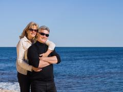 happy romantic middle-aged couple at the sea - stock photo