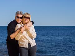 relaxed healthy couple enjoying the coast - stock photo
