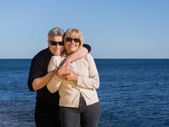 romantic happy mature couple relaxing at the coast - stock photo