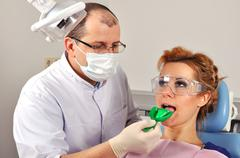 dentist makes an impression - stock photo