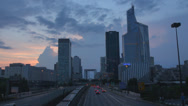 Stock Video Footage of La Defense district traffic car street metro train pass Twilight Paris storm day