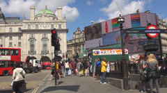 Piccadilly Circus iconic square video display famous London sunny day people  Stock Footage