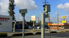 Automatic Traffic Ticket Cameras With Businesses In Background Stock Footage