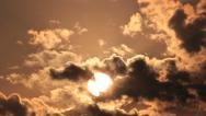 Stock Video Footage of Sunrise through flowing cloud waves