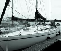 Sailing yacht tied up to pontoon in marina berth - stock photo