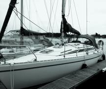 Sailing yacht tied up to pontoon in marina berth Stock Photos
