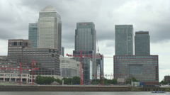 Canary Wharf financial district Thames River London cloudy day business building Stock Footage
