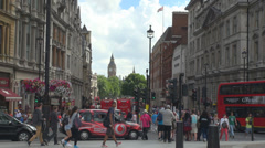 Busy street traffic car red bus double-decker black taxi London UK Great Britain Stock Footage