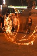 Fire show in the street of night city Stock Photos