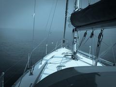 A yacht becalmed. Stock Photos