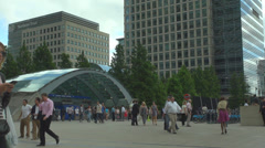 People walk Canary Wharf London business centre metro station tube cloudy day  Stock Footage