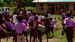 Ugandan orphan school children playing In School yard Stock Footage