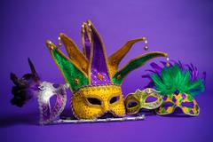 assorted mardi gras or carnivale mask on a purple background - stock photo