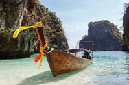 Stock Photo of traditional longtail boats in the famous maya bay of phi-phi leh island, thai