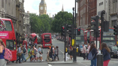 Big Ben tower bell clock icon traffic car London street double decker red bus Stock Footage